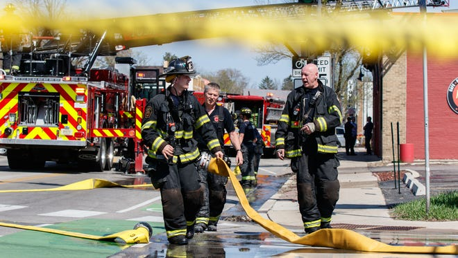 Emergency personnel work the scene of a fire in the Red Dot bar/restaurant at 6715 W. North Ave. in Wauwatosa on Monday afternoon, May 7, 2018.