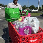 Cathy Mistretta, left, and Brae Carroll stock up supplies for homeless students in Brevard County.