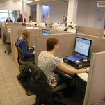 Job seekers use Great Falls Job Service computers to look for job listings and apply for work.