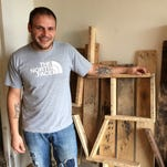 Ken Garbisch, owner of Ken's Kustom Woodworking in Rosendale, displays wall hangings he's built from  used pallets.