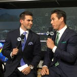 Joe Davis (left) talks play-by-play in front of the camera during a Fox Sports broadcast with Eric Karros. The 28-year-old grew up in Charlotte and Potterville but signed a multi-year deal a month ago to announce games for the Los Angeles Dodgers.