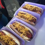 """This Tuesday, Feb. 9, 2016, photo, shows a Burger King """"classic"""" hot dog at a media event to introduce the restaurant's new menu item, in New York. Burger King plans to start selling the hot dogs in the U.S. on Feb. 23. The company says it will offer two options of grilled dogs, a """"chili cheese"""" and """"classic"""" that has relish, onions, ketchup and mustard. (AP Photo/Candice Choi)"""