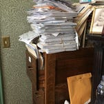 The author's home file cabinet is topped off by a precarious stack of papers.