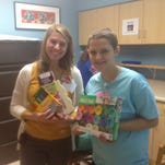 Beth Borens, right, presents hundreds of items to the Monroe Carell Jr. Children's Hospital at Vanderbilt on Jan. 13 as part of item number 1 on her bucket list.