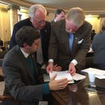 State Reps. Toby Barker (from left), John Read and Jeff Smith, discuss Senate Bill 2407, which the House Public Health and Human Services Committee just passed on Tuesday.