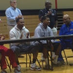 Plain Dealing's Chiner Long (middle) celebrates his scholarship signing with Southern-Shreveport on Monday in Plain Dealing.