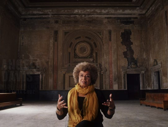 Civil rights activist Angela Davis is interviewed inside