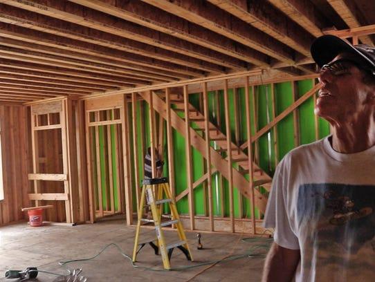 Scott Edrington checks on the progress at his Ortley