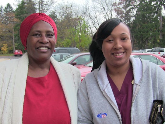Battle Creek voters Dawn Armstrong, left, and Shiann