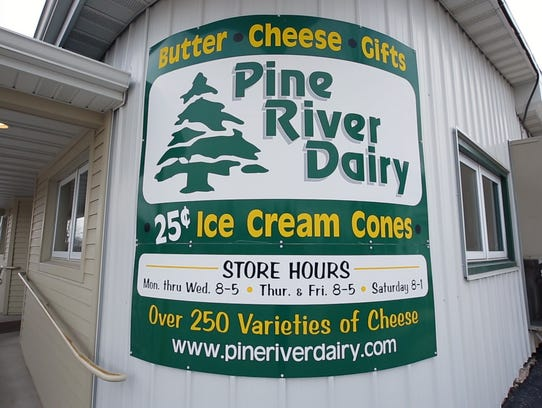 The Pine River Dairy sign outside the store at the