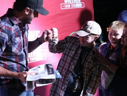 Iowan Max Bird meets country star Luke Bryan at the