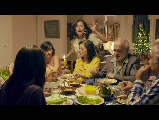 "A scene from ""Congratulations,"" a film about an Arab family who suddenly receives a fortune, but must keep it a secret from those to whom they owe money."
