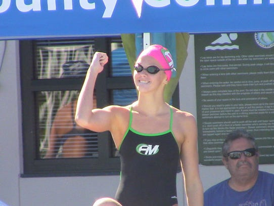 Fort Myers freshman swimmer Olivia McMurray pumps herself