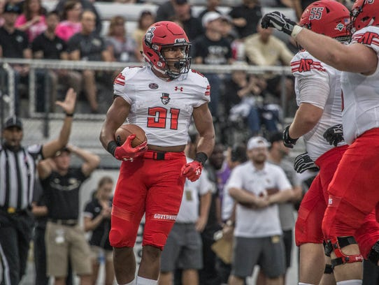 Austin Peay running back Ahmaad Tanner celebrates with