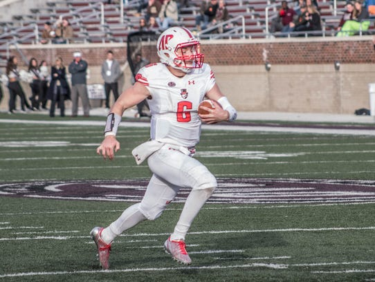 Austin Peay quarterback Jeremiah Oatsvall carries the