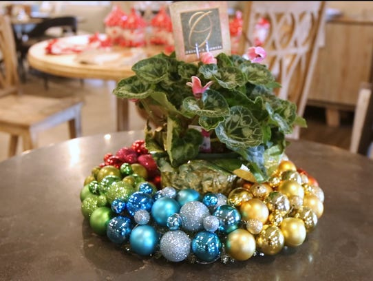 For a quick and easy centerpiece for the holidays all you need is a wreath and a plant to sit in the middle