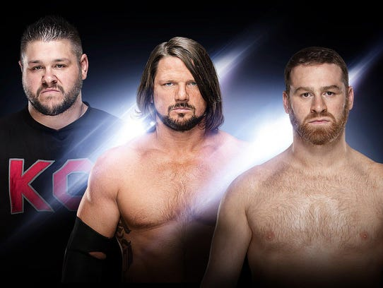 Kevin Owens (from left), AJ Styles and Sami Zayn appear