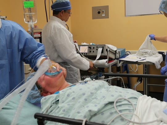 Dr. Ivan Mazzorana watches for indication Carolyn's