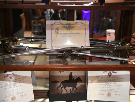 A cabinet of Johnson's swords and other accolades on