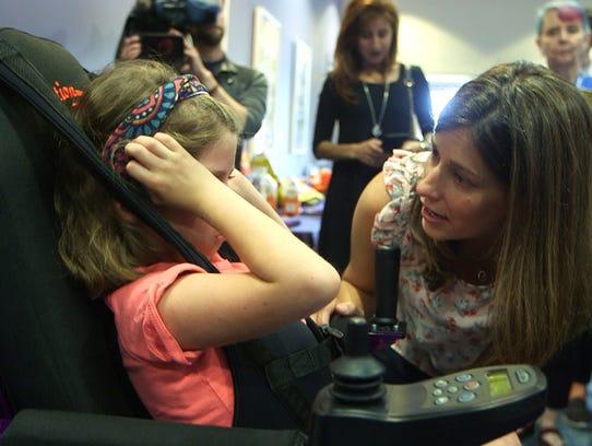 Emily Pedersen talks with daughter Klara after Make-A-Wish