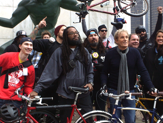 Michael Bolton with riders from Slow Roll Detroit in