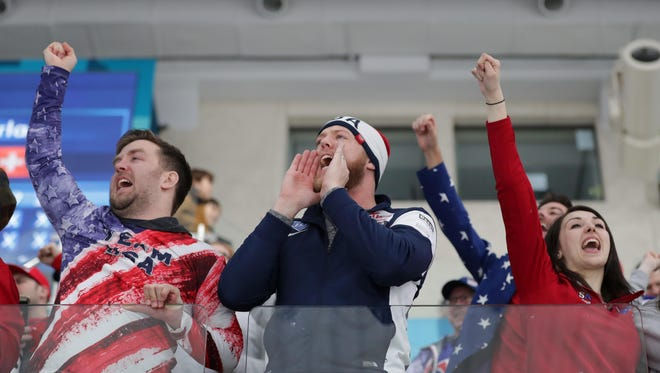 An United States fan cheers during the match against Canada in the men's curling semifinal during the Pyeongchang 2018 Olympic Winter Games at Gangneung Curling Centre.