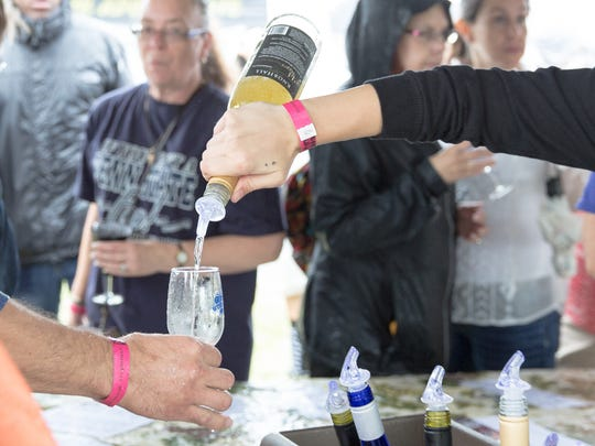 Festival-goers can enjoy wine tastings during the Wine Tasting in the Park event at Elickers Grove Park in Spring Grove.