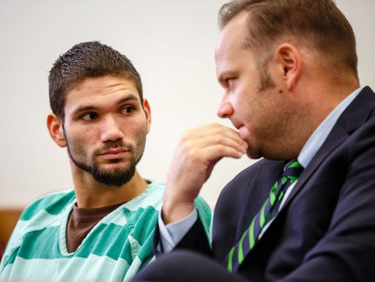 Taylor Linse, left, meets with his attorney Nate Mundy