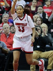 Louisville's Bionca Dunham celebrates after scoring