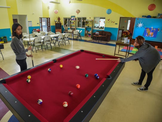 Chelsea Sablan, 15, takes a shot during a game of 8-ball
