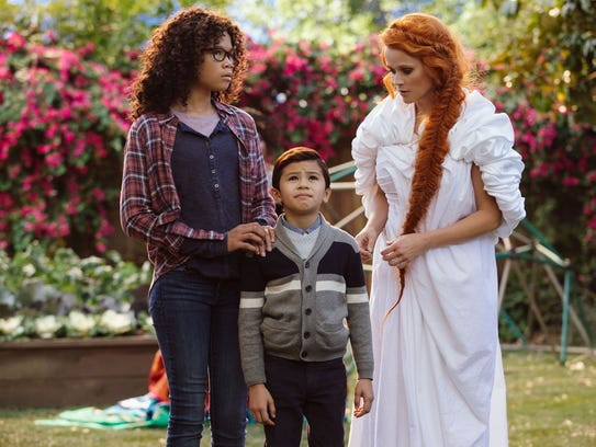 "Meg Murry (Storm Reid) and her brother Charles Wallace (Deric McCabe) get a crash course in interdimensional travel from Mrs. Whatsit (Reese Witherspoon) in ""A Wrinkle in Time,"" whose original novel combined science and religious themes."