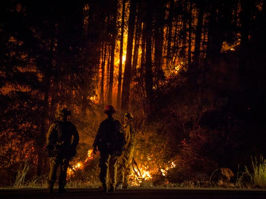 Firefighters keep a watchful eye on the Carr Fire as