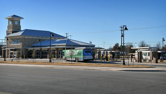 In this file photo, city buses park at the Clarence Muehlberger Travel Center. The center will soon have an addition that will allow passengers to have access to restrooms and a climate-controlled seating area after the center's regular hours.