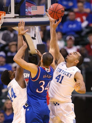 Kentucky Wildcats forward Trey Lyles (41) goes up with teammate Dakari Johnson (44) to try and stop a shot by Kansas Jayhawks forward Perry Ellis (34) in the second half.  Kentucky and Kansas squared off in game two of a college basketball doubleheader at Bankers Life Fieldhouse Tuesday, November 18, 2014.