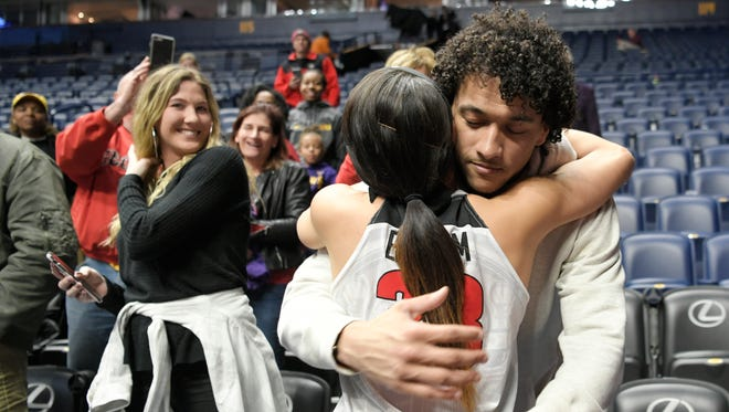 New York Giants football player Evan Engram hugs his sister Georgia forward Mackenzie Engram (33) after beating Missouri during the quarterfinals at the 2018 SEC Women's Basketball Tournament  at Bridgestone Arena in Nashville on Thursday, March 2, 2018.