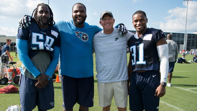 Titans outside linebacker Erik Walden (58), defensive end Jimmy Staten (69), and safety Kevin Byard (31) pose for a picture with their former college football coach from MTSU Rick Stockstill after the first practice of training camp at Saint Thomas Sports Park Saturday, July 29, 2017 in Nashville, Tenn.