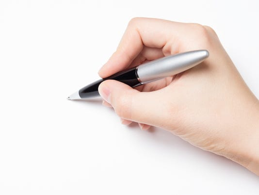 female hand with pen over white
