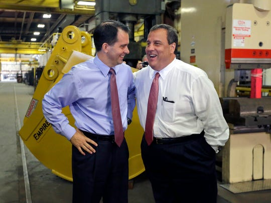 New Jersey Gov. Chris Christie, right, and Wisconsin Gov. Scott Walker share a laugh Sept. 29 as Walker campaigns at Empire Bucket in Hudson. Walker, Christie and former Florida Gov. Jeb Bush are among at least 10 current and former governors considering a bid.