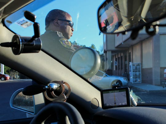 Edward talks with dispatchers  at a traffic stop.