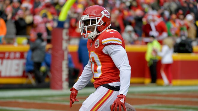 Kansas City Chiefs wide receiver Tyreek Hill (10) celebrates after a play during the first half against the Miami Dolphins at Arrowhead Stadium.