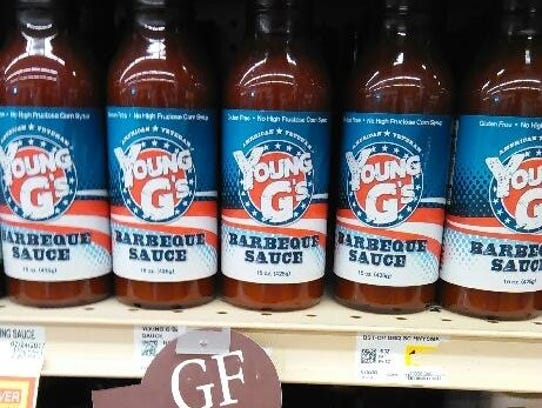 Young G's Barbecue Sauce on supermarket shelves.