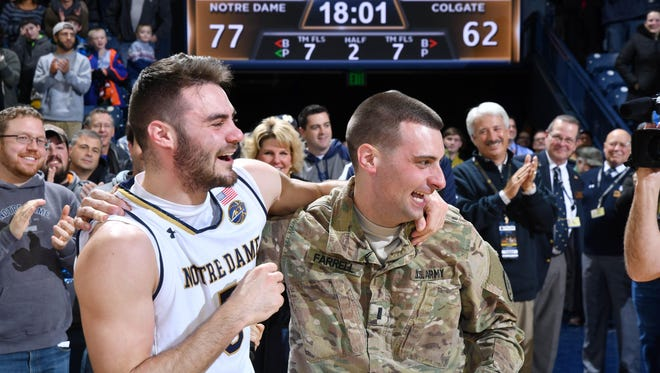 Dec 19, 2016; South Bend, IN, USA; Notre Dame Fighting Irish guard Matt Farrell (5) greets his brother, First Lieutenant Bo Farrell (R), who had been serving with the U.S. Army in Afghanistan. Lt. Farrell made a surprise appearance following the game against the Colgate Raiders at the Purcell Pavilion. Notre Dame won 77-62. Mandatory Credit: Matt Cashore-USA TODAY Sports