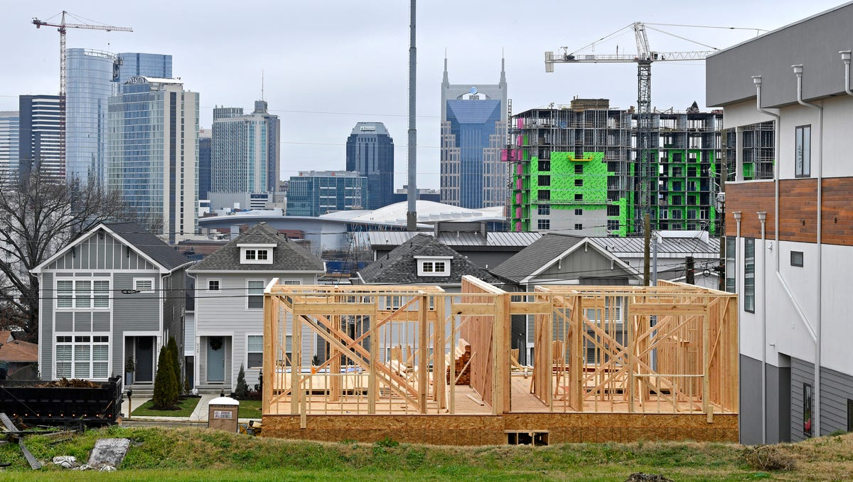 A view of the Nashville skyline from Archer Street, South of town, shows new construction and larger houses pushing out longtime residents and changing the demographics of the neighborhood.Thursday Dec. 21, 2017, in Nashville, TN