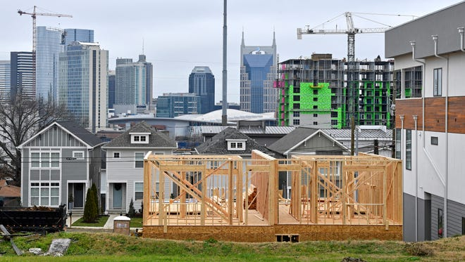 A view of the Nashville skyline from Archer Street, south of town, shows new construction and larger houses.