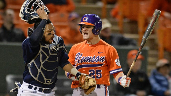 Both Clemson catcher Chris Okey (25) and Maine catcher Jonathan Salcedo (99) react after Okey struck out giving Maine a 4-3 win in the Tigers season opener Friday, February 19, 2016 at Clemson's Doug Kingsmore Stadium.