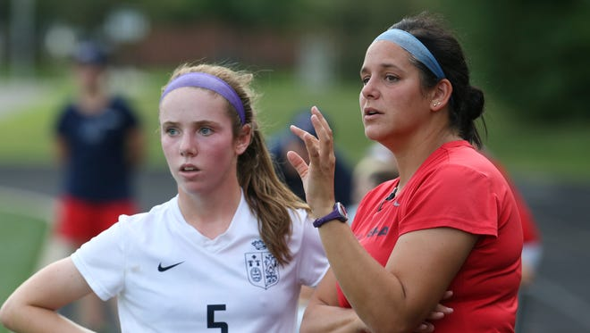 Sacred Heart head coach Jaclyn Puntillo gave instructions to Ashley Durik, #5, against Lexington Catholic during their match at Sacred Heart.  Sacred Heart won 2-1.
