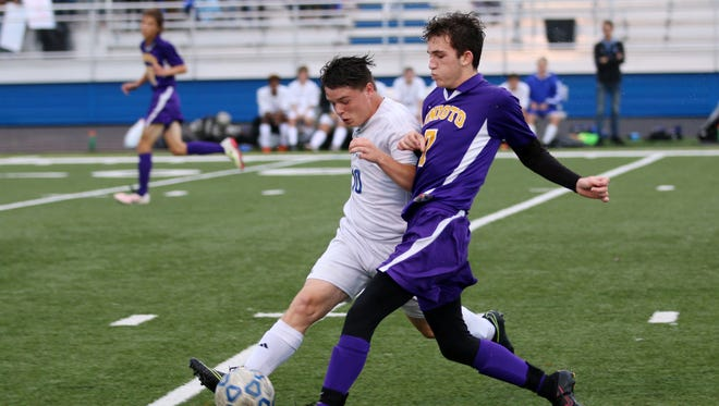Chillicothe's John Graves fights for possession of the ball against Unioto's Ryan Smith Thursday at Herrnstein Field.