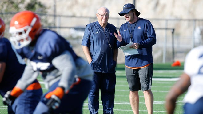 Interim head coach Mike Price stands with offensive coordinator Brian Natkin as both watched practice, in preparation for Saturday nights game against CUSA Champion Western Kentucky. Price spent most of his first day back on the job taking notes of what he saw during his first practice with the team since taking over for Sean Kugler.