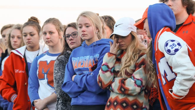 Marshall County High School student Keatyn Gamble wipes away tears during a prayer circle at Paducah Tilghman High School on Wednesday morning.  Students held the prayer circle for Marshall County High School after a shooting left two students dead and 18 more injured.January 24, 2018