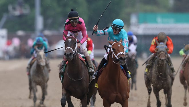 Monomoy Girl, right, with Florent Geroux aboard, nips Wonder Gadot, with John Velazquez to win the 144th Running of the Kentucky Oaks.